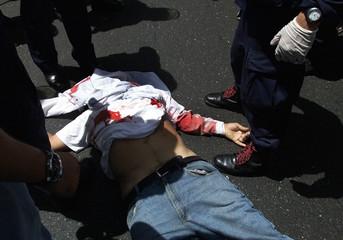 A BODY OF A VENEZUELAN MAN LIES ON THE FLOOR AFTER BEING SHOT DEAD INCARACAS.