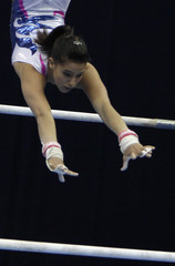Switzerland's Tacchelli competes on uneven bars during apparatus finals at Artistic Gymnastics World Cup in Moscow