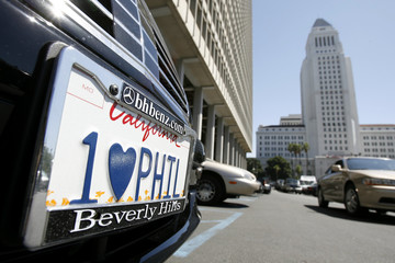 License plate of car carrying defendant Phil Spector and wife to court session in Spector's murder trial in Los Angeles