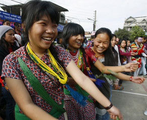 Kirant girls wearing traditional ornaments take part in the Sakela Udhauli festival in Kathmandu