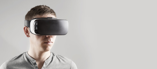 Young man in virtual reality, vr glasses.