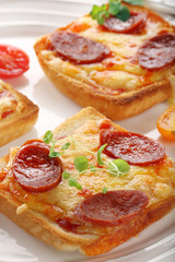 Fresh toast with cheese and chorizo sausage