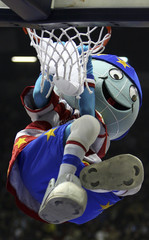 Harlem Globetrotters mascot hangs from basket during exhibition game with NY Nationals in Istanbul