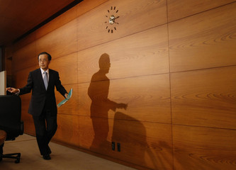 Bank of Japan Governor Masaaki Shirakawa leaves a room after a news conference in Tokyo