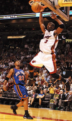 Miami Heat Wade dunks over Richardson of New York Knicks during NBA game in Miami
