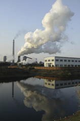 Smoke billows out of a power plant on the outskirts of Nanjing