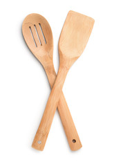 Top view of wooden kitchen spoon and spatula