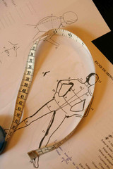 Tape measure and costume fitting diagrams seen during cast costume measurements meeting in Paris
