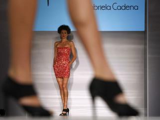 A model displays a creation by Gabriela Cadena of Ecuador on the third day of Miami Fashion Week in Florida