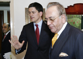 Pakistan's Foreign Minister Khursheed Mehmood Kasuri greets Britain's Foreign Secretary David Miliband at the foreign ministry in Islamabad