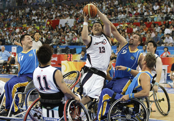 Japan's Fujimoto fights for the ball against Sweden's Wallin at the Beijing Paralympic Games