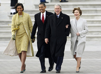 President Obama and first lady Michelle walk with former President Bush and his wife Laura during the departure ceremony at the inauguration in Washington