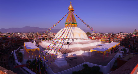 Kathmandu city view in the morning after sunrise with buddhist Boudhanath Stupa temple after renovation in the end of 2016. Tibetan traditional architecture, Nepal. Horizontal cityscape panorama