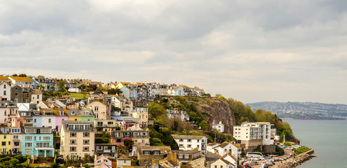 Hills in the seaside town, beautiful colored facades of buildings, panorama seaside town