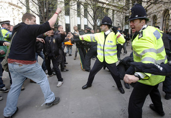 Police officers clash with protesters during demonstrations opposing the G20 summit in the financial district of the City of London