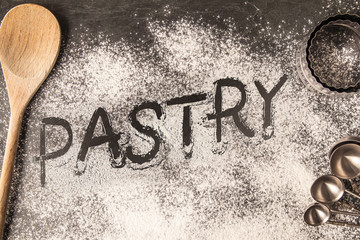 Handwritten word drawn in the flour - Pastry