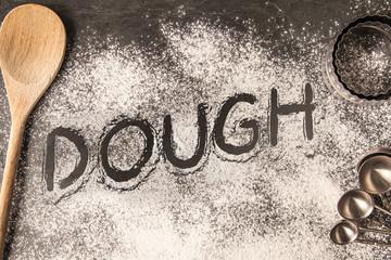 Handwritten word drawn in the flour - Dough