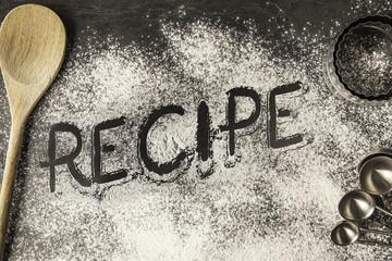 Handwritten word drawn in the flour - Recipe