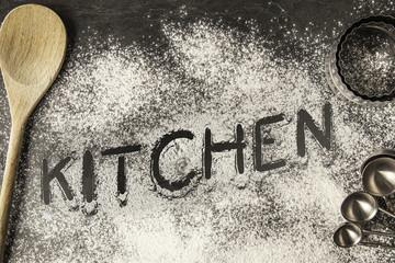 Handwritten word drawn in the flour - Kitchen
