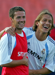 Real Madrid's Michael Owen smiles with Michel Salgado during training in Budapest.