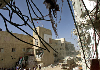 PALESTINIAN BULLDOZERS CLEAR RUBBLE AFTER THE ISRAELI ARMY WITHDREWFROM PALESTINIAN PRESIDENT ...