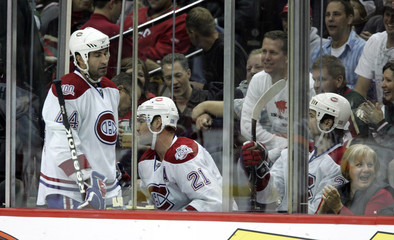 Canadiens Hamrlik joins Higginsa and Lang in penalty box during NHL game against the Minnesota Wild in St. Paul