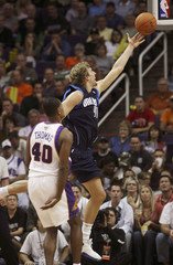 Dallas Mavericks Dirk Nowitzki scores against Phoenix Suns in Phoenix, Arizona