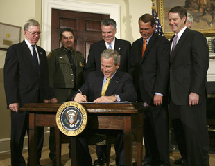 U.S. President Bush signs the Secure Fence Act of 2006 in Washington