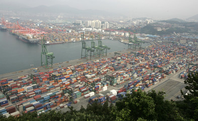 Containers are piled up at a yard in Busan port, the country's biggest and the world's No. 5 container port, in Busan