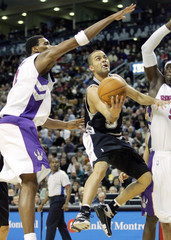 Spurs guard Parker drives past Raptors forward Bosh in Toronto
