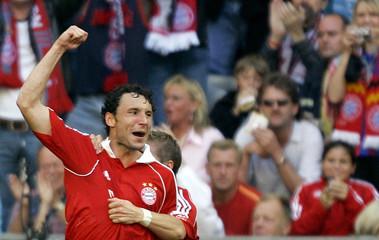 Bayern Munich's van Bommel celebrates his goal during a German Bundesliga first division soccer match against Alemannia Aachen in Munich