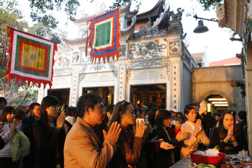 Pilgrims pray at Phu Tay Ho temple during the Tet, or Lunar New Year festival, Vietnam's most important festival of the year, in Hanoi