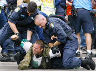 PROTESTER ARRESTED BY POLICE AT INFORMAL WTO MEETING IN SYDNEY.