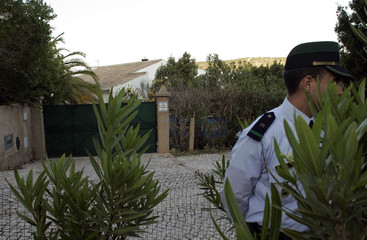 A policeman guards a villa that has been sealed for forensic tests near the Portuguese beach resort of Lagos