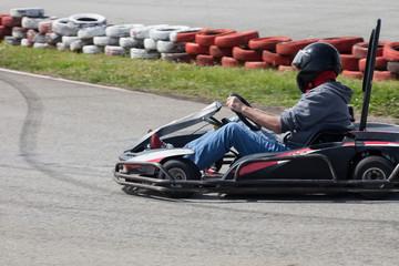 Foto op Aluminium F1 man drive go kart on track back view