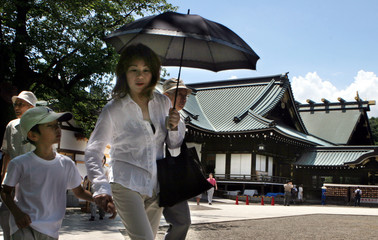 Woman and her son visit Yasukuni Shrine, a shrine for war dead seen by many in Asia as symbol of Japan's past militarism, in Tokyo