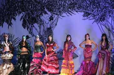 Models present creations from the Mark Cheung Haute Couture Collection 2006 at the China Fashion Wee..