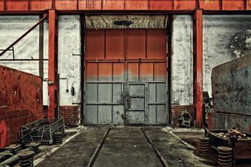 Fototapete - Industrial door of a factory