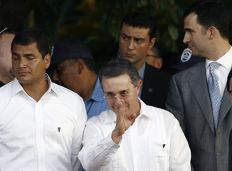 President Alvaro Uribe of Colombia waves in Managua