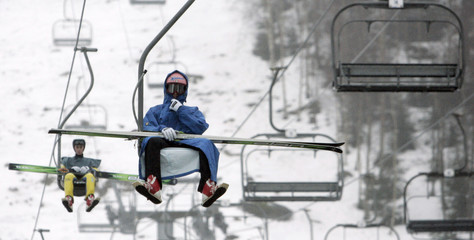 Italy's Andrea Morassi goes down on a lift chair from a flying hill in Harrachov