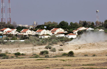 An Israeli tank patrols in the Jewish settlement Netzarim in Gaza Strip.