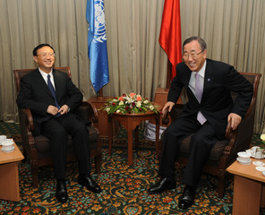 China's Foreign Minister Yang Jiechi and United Nations Secretary-General Ban Ki-Moon smiles before meeting in Yangon