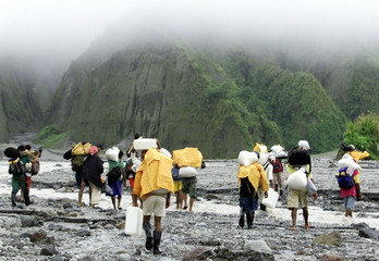 FILIPINO AETAS TRIBESMEN HEAD TO THE CRATER OF MOUNT PINATUBO.