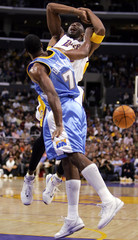 Denver Nuggets Buckner knocks the ball out of the hands of Los Angeles Lakers Bryant in Los Angeles