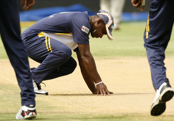 Sri Lanka's Sanath Jayasuriya examines the pitch in Kingston