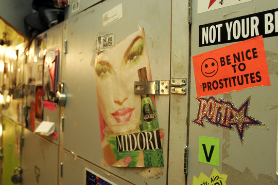 Stickers are posted to locker doors at the Lusty Lady peepshow in San Francisco