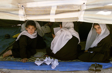 AFGHAN CHILDREN ATTEND LESSONS UNDER A TENT IN KABUL.