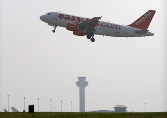 An passenger jet takes off from Stansted Airport in Essex, southern England