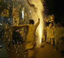 Supporters of Pakistani President Pervez Musharraf celebrate his victory in Presidential election in Islamabad