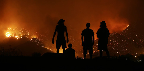 Residents watch the Sawtooth fire in Morongo Valley